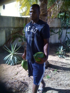 Junior walking w coconuts