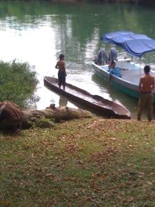 village-boys-inspect-cayuco